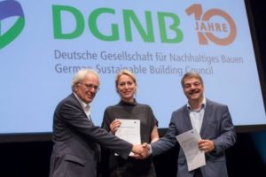 DGNB President Prof Alexander Rudolphi pictured with DGNB CEO Dr Christine Lemaitre and Peter Matteo (Groß & Partner) at the signing of the contract